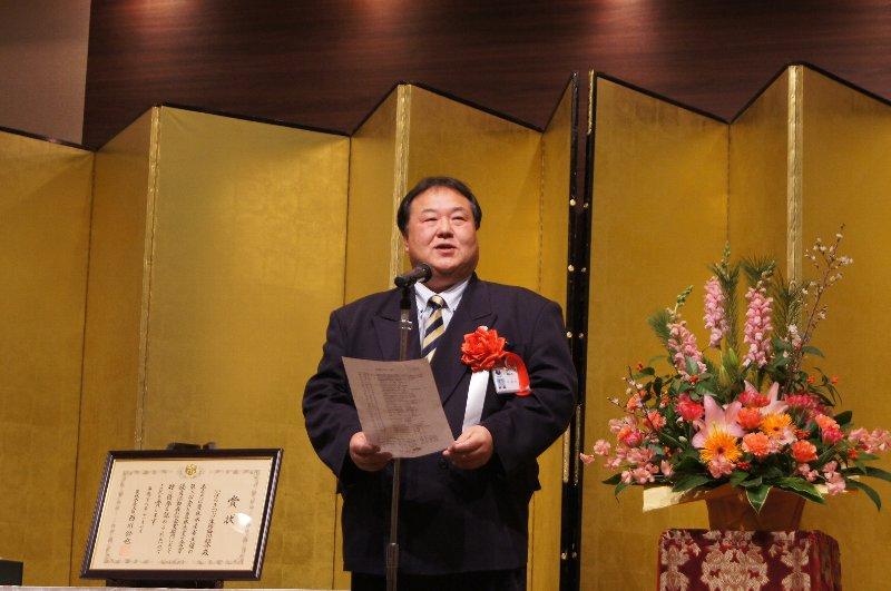 挨拶する茨城県教育庁生涯学習課副参事 小沼公道様